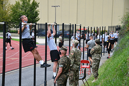 Cadets completing fitness test with pull-ups