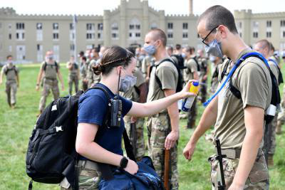Savanah Diamond '22, one of VMI's many cadet EMTs, applies sunscreen to a rat during Matriculation Week.—VMI Photo by Mary Price.